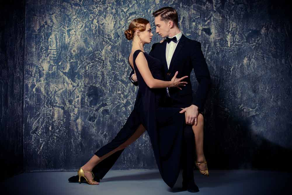 Two Strictly dancers in a passionate embrace