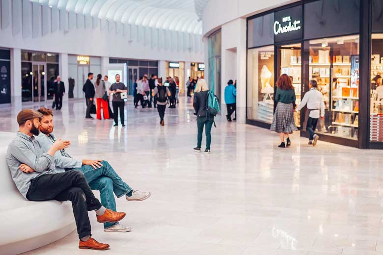 Customers enjoy a chat at the new Icon Outlet at the O2